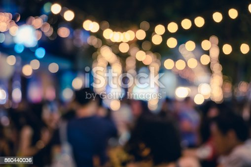 istock Festival Event Party with People Blurred Background 860440036