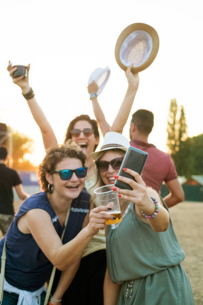 festival fun - concert selfie stock photos and pictures