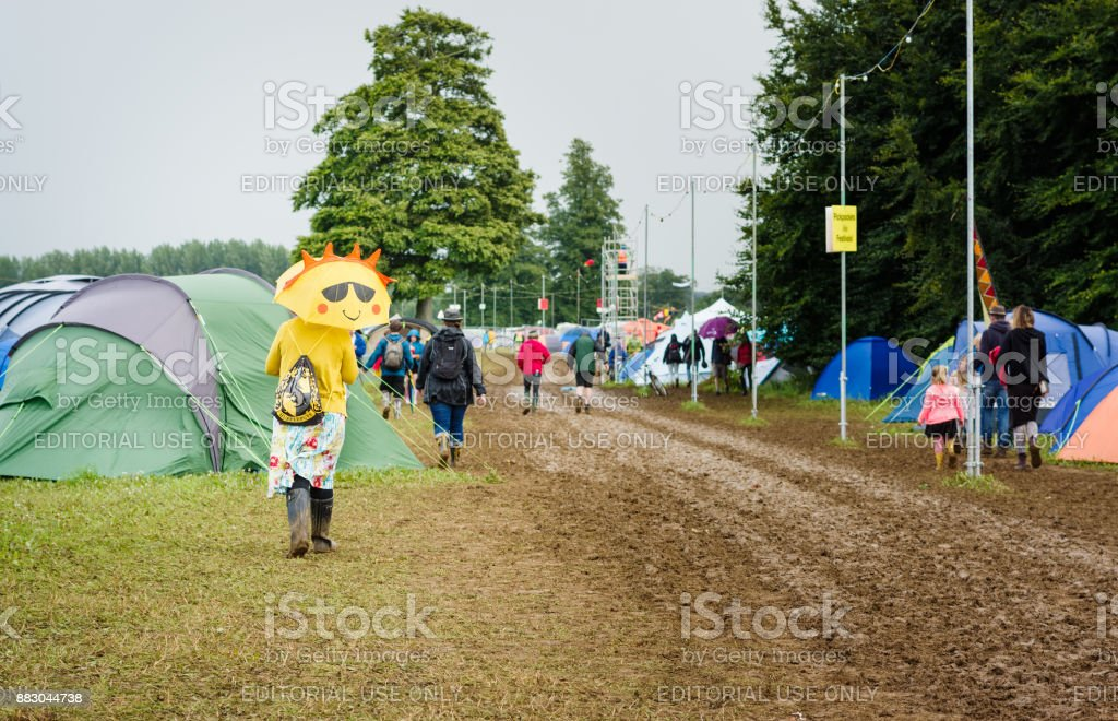 Festival goer at muddy Womad stock photo