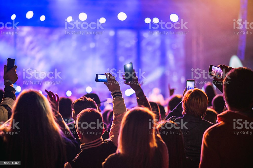 Festival goers filming a pop music concert stock photo
