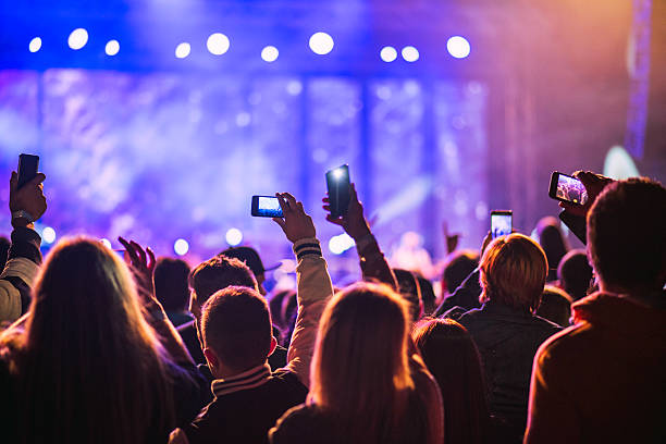 Festival goers filming a pop music concert - Photo