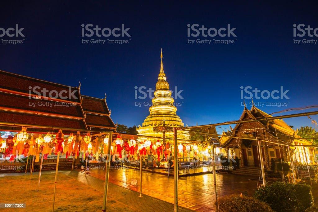 Festival lanterns hanging colorful night dark inside Wat Phra Haripunchai. Lamphun Thailand background stock photo