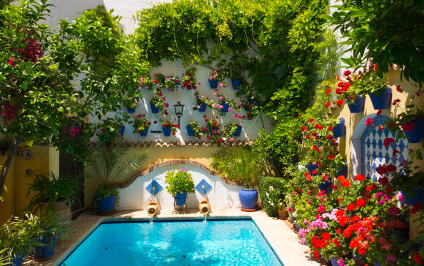 Festival de los Patios Cordobeses 2017 traditional flower-decorated patio in cordoba, spain, duriing the Festival de los Patios Cordobeses cordoba spain stock pictures, royalty-free photos & images