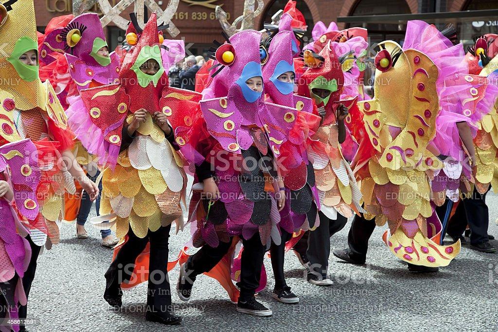 Festival parade children dressed as fish stock photo