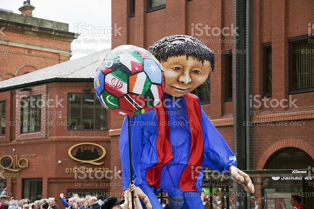 Festival parade with a footballer figure stock photo