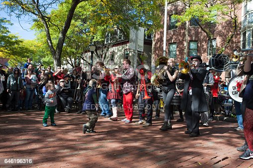 Somerville, Massachusetts, USA - OCTOBER 10, 2015 - first day of HONK Festival. Festival of activist street bands. Brass Bands in outlandish costumes playing on instruments and dancing. People are enjoying by the sight.