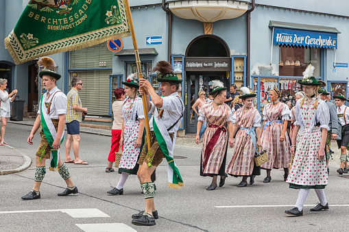 istock Festival with parade of fanfare and people in traditonal costumes 904999932