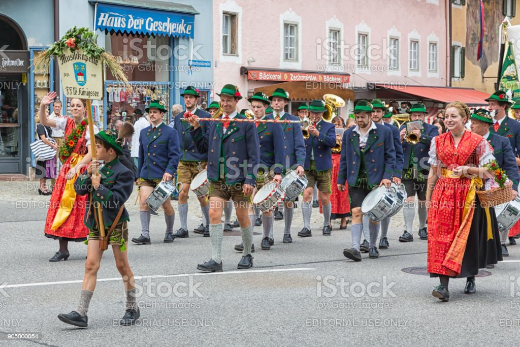 Festival with parade of fanfare and people in traditonal costumes stock photo