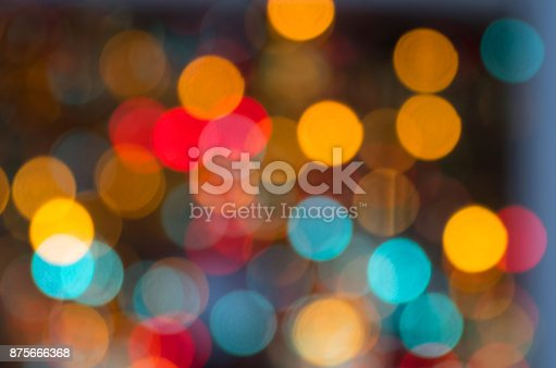 istock Festive, abstract background - glitter lights as colorful blurs 875666368