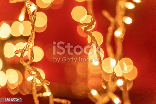 857847778 istock photo Festive abstract background with bokeh defocused Christmas lights 1189127042