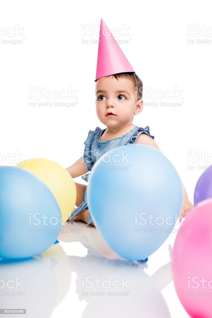 Festive baby girl with balloons and hat - foto de stock
