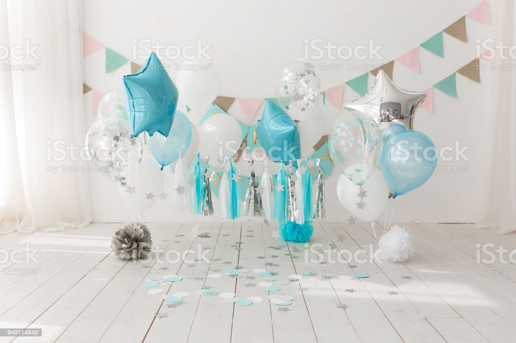 Festive background decoration for birthday celebration with gourmet cake and blue balloons in studio, cake smash first year concept royalty-free stock photo