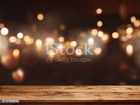 istock Festive background in front of empty table 615480840