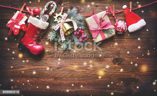 858960516istockphoto Festive background with Christmas presents, Santas accessories and decoration on the clothesline 858960516