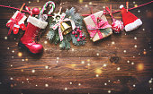 Festive background with Christmas presents, Santas accessories and decoration on the clothesline