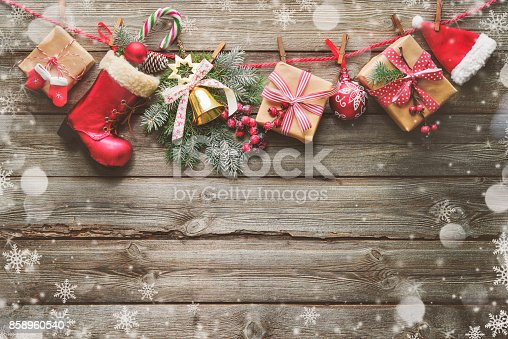 858960516istockphoto Festive background with Christmas presents, Santas accessories and decoration on the clothesline 858960540
