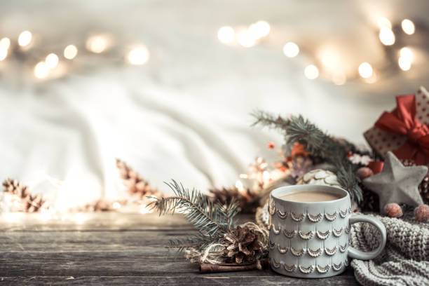 festive background with cup on wooden background with lights. - vacations food stock pictures, royalty-free photos & images