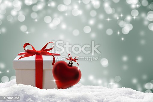 istock festive background with gift and heart shape 997564038