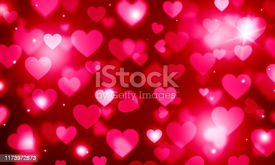 896306118istockphoto Festive background with red hearts, bokeh, love, romance, blurred, red, Valentine's day, pink, glitter 1173972873