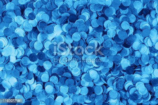 Blue confetti background. Flat lay style. Festive concept