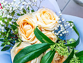 A festive bouquet of cream rose garden flowers. Mothers Day. Birthday. Bridal bouquet. Day of Remembrance. International Women's Day. Place for text. Background image. Advertising. Holiday gift.