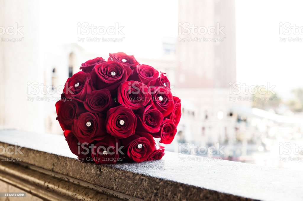 Festive bouquet of red roses on wedding day stock photo