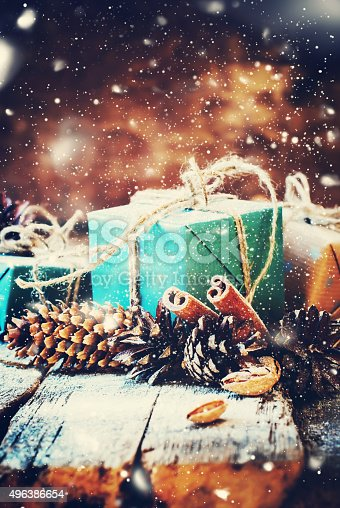 493890050 istock photo Festive Box with Pine cones on Wooden Background. Drawn Snow 496386654