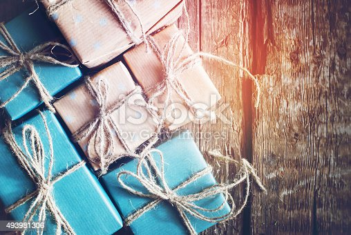 493890050 istock photo Festive Boxes are Packed into  Brown Paper with Linen Cord 493981306
