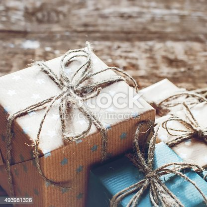 493890050istockphoto Festive Boxes in a Brown Paper with Linen Cord 493981326