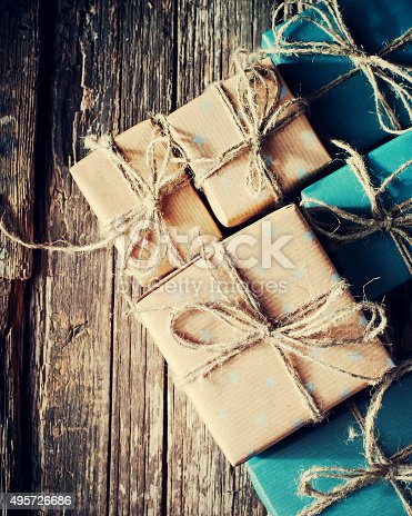 493890050istockphoto Festive Boxes with Linen Cord. Color Gifts. Toned 495726686