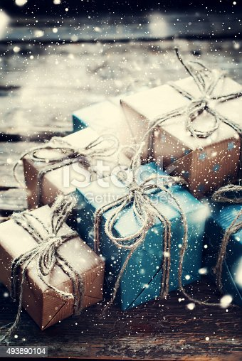 493890050 istock photo Festive Boxes with Linen Cord. Drawn Snow 493890104
