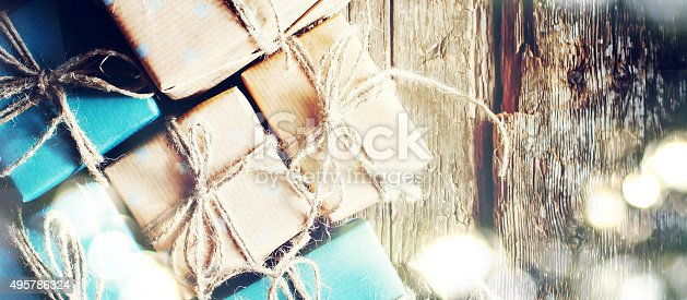 493890050istockphoto Festive Boxes with Linen Cord. Shining Boke. For Web Design 495786324