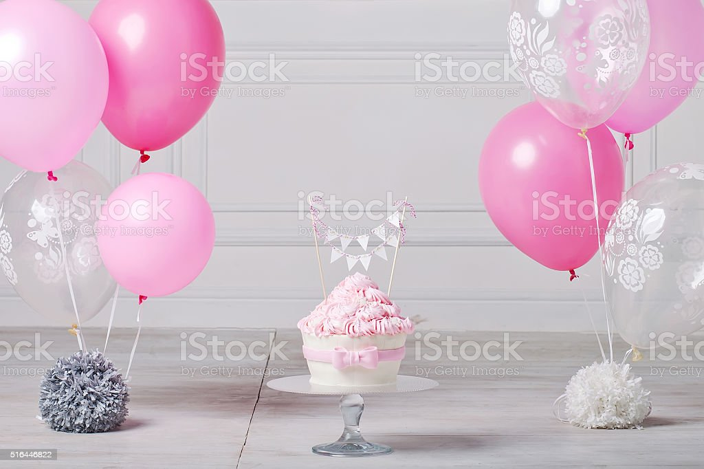 Festive cake and balloons. White and pink color stock photo