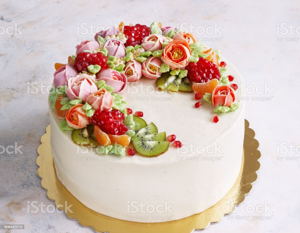 Festive cake with cream flowers and fruits on a light background festive cake with cream flowers and fruits on a light background royalty free stock photo izmirmasajfo