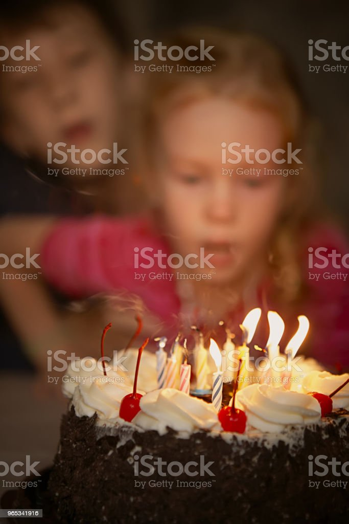 Festive candles blow out on a birthday cake royalty-free stock photo