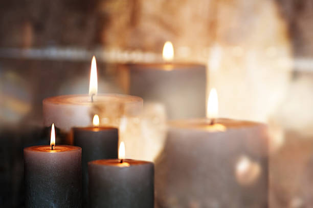 festive candles - grief stock photos and pictures
