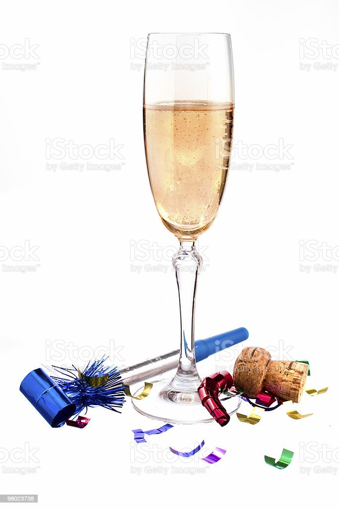 festive champagne with noisemaker royalty-free stock photo