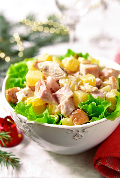 festive chicken salad with pineapple in a white bowl. - ananas huhn salate stock-fotos und bilder