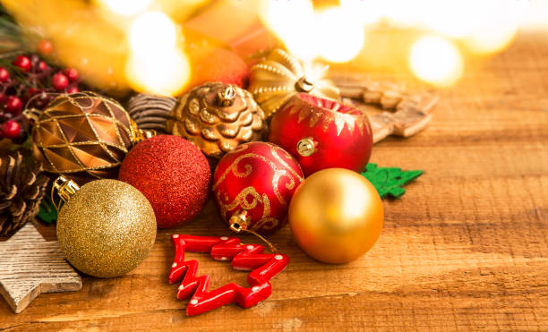 Festive Christmas balls decorations with bokeh golden lights on a wooden  board, rustic winter holidays - Royalty Free Romanian Christmas Ornaments Pictures, Images And Stock
