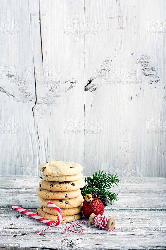 Festive Christmas card. Homemade cookies with chocolate drops for Santa stock photo
