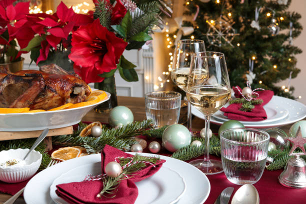 Festive Christmas Day Table with Roast Turkey and Wine stock photo