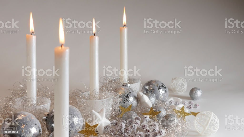 festive christmas decoration with four candlelights glitter balls and sparcling angel hair royalty free