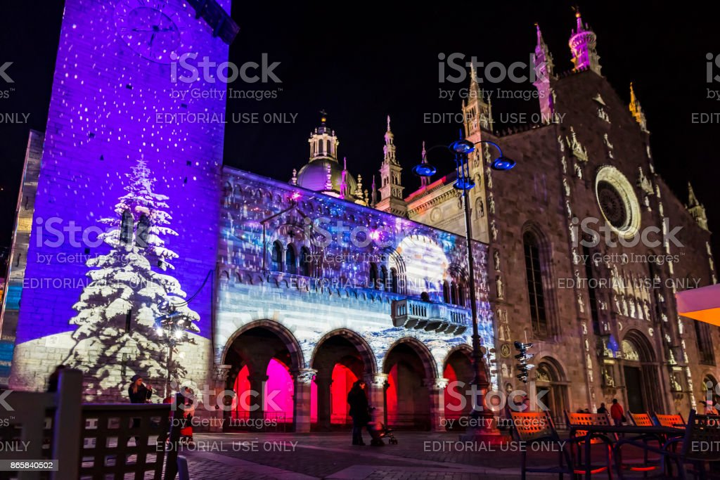 festive christmas decorations on facades of buildings in como italy royalty free stock photo
