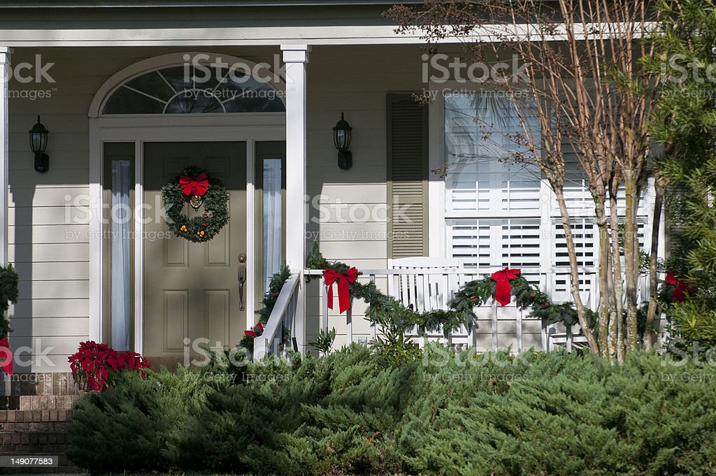 Festive Christmas wreath decorated front door stock photo