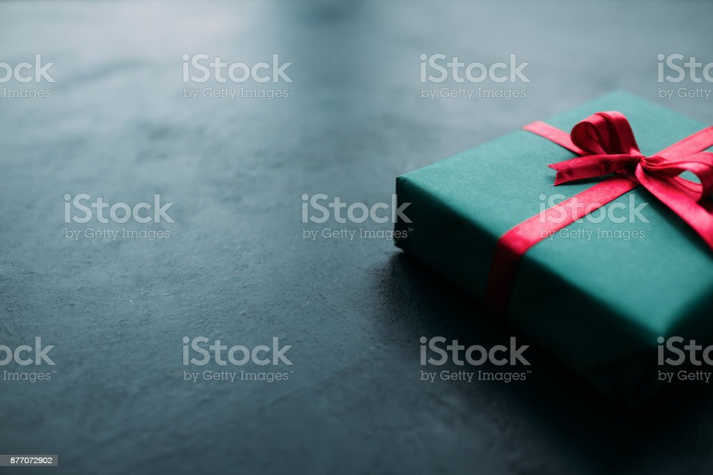 Festive closed gift box on grey background stock photo