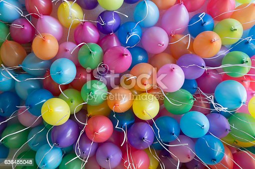 istock festive, colorful balloons with helium attachment to the white ribbons 636455048