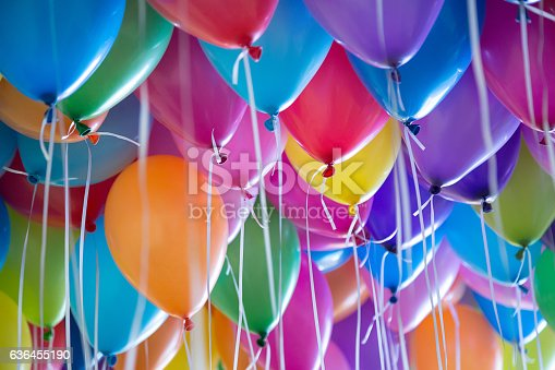 istock festive, colorful balloons with helium attachment to the white ribbons 636455190