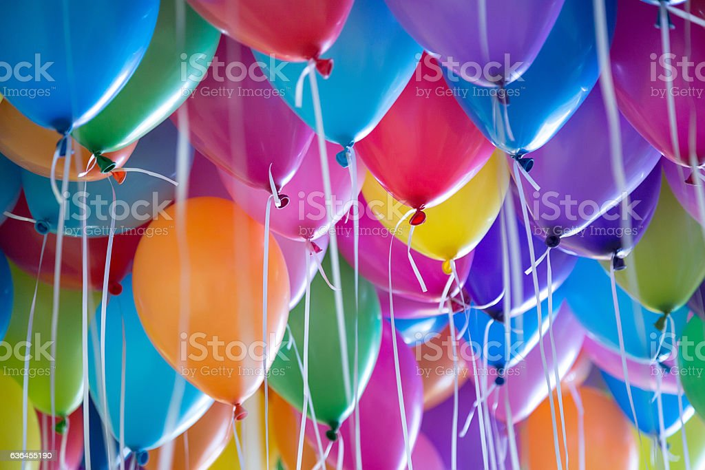 festive, colorful balloons with helium attachment to the white ribbons bildbanksfoto