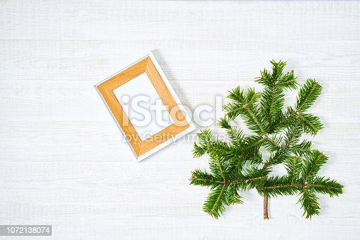 1064023690 istock photo Festive composition of Christmas decorations on white wooden background. 1072138074