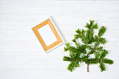 istock Festive composition of Christmas decorations on white wooden background. 1072138074